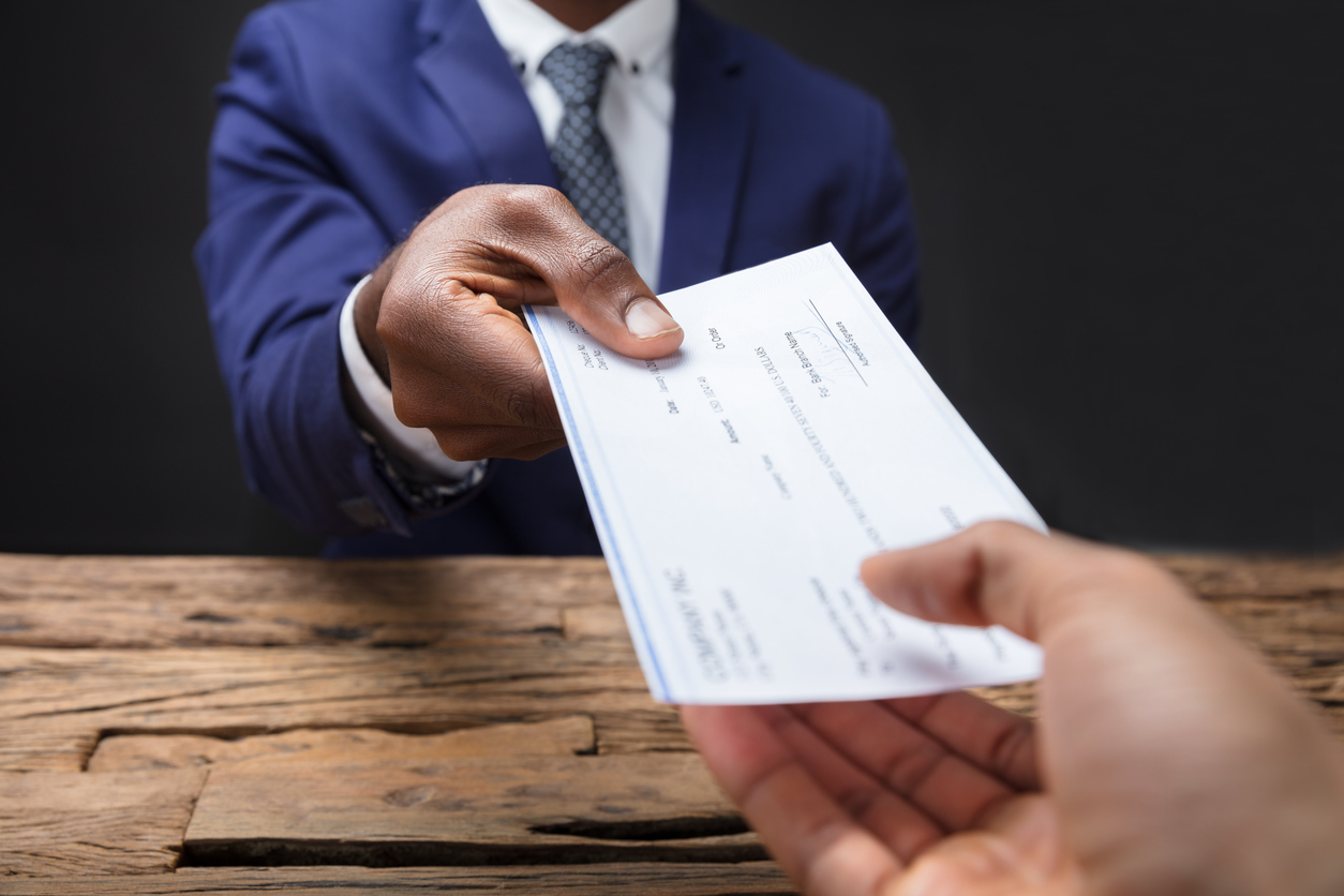 Man handing over check